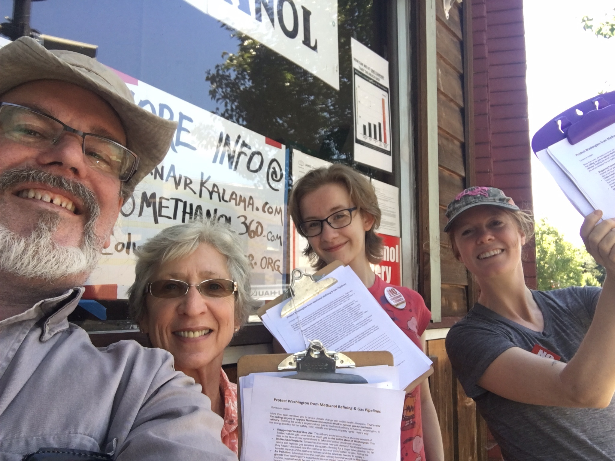 Four productive no methanol activists outside our No Methanol Meeting Hall, summer 2017.